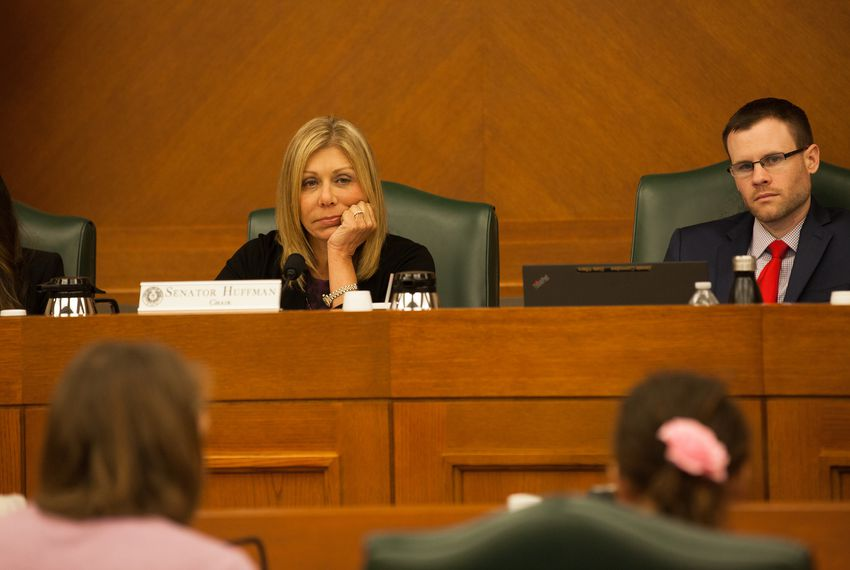 "State Sen. Joan Huffman, R-Houston, listens to the Gonzales family speak against SB 3 and SB 91, the ""bathroom bills,"" before the Senate State Affairs Committee on July 21, 2017."
