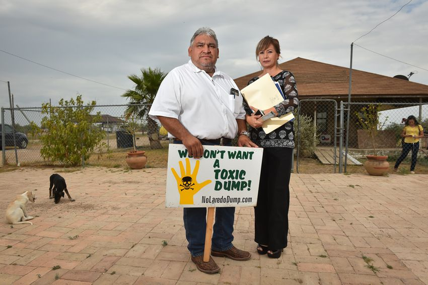 Alejandro Obregon and his wife, Rocio, stand in front of their home near the site of a landfill proposed by developer C. Y. Benavides, about 20 miles east of Laredo. Their daughter, Abigail, is at right.