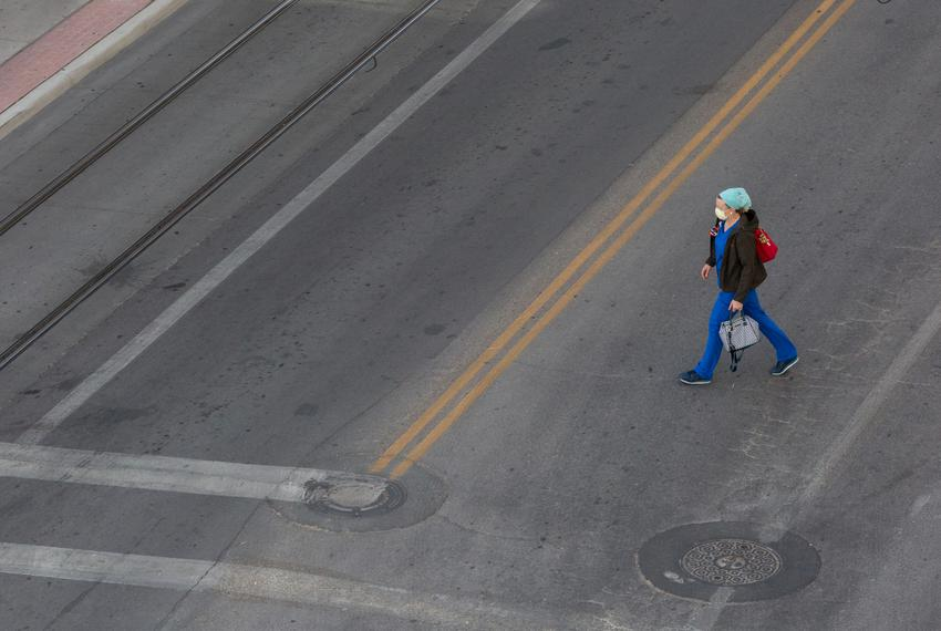 A medical workrs walks near Las Palmas Medical Center in El Paso.