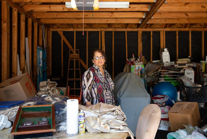 Shammi Bajaj stands in her garage where salvaged belongings from Hurricane Harvey remain to be sorted in Houston, Texas.