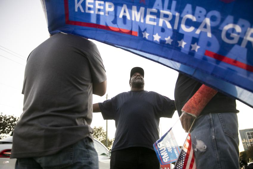 Supporters engage outside of the Metropolitan Multi-Services Center during Election Day in Houston on Nov. 3, 2020.