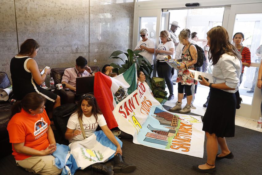 "Opponents of Senate Bill 4 — which would outlaw ""sanctuary"" jurisdictions in Texas — stage a protest at the State Insurance Building in Austin on May 1, 2017."