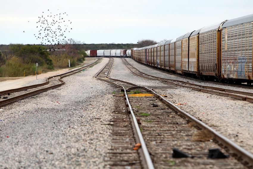 Coal from the Dos Republicas site in rural Maverick County is carried by train through the center of Eagle Pass, Texas, an...