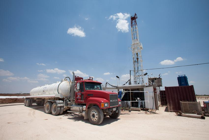 A water truck parked near a drilling rig operated by Fasken Oil and Ranch, Ltd.. Drilling rigs use of water is a salient iss…