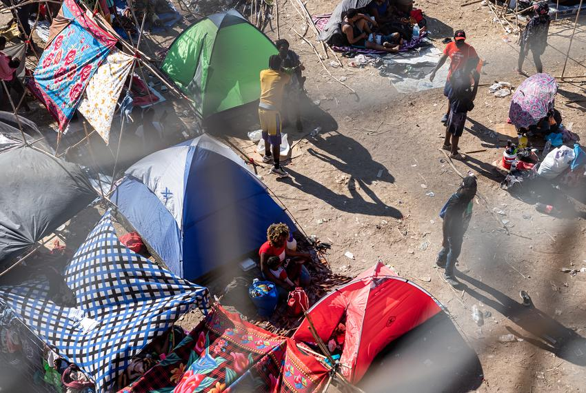 Migrants at a temporary migrant camp under the international bridge in Del Rio on Sept. 17, 2021.