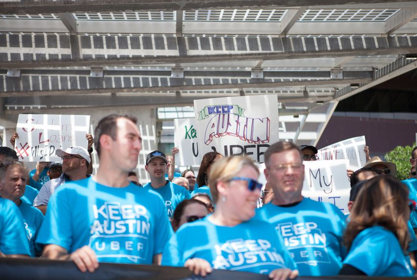 Austin Uber drivers participate in a September rally against a proposal by the Austin Transportation Department to set regulations similar to those for traditional taxi drivers such as fingerprint-based background checks. The Austin City Council passed the proposal in December, and Uber and Lyft threatened to pull out of the city.