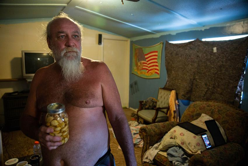 "Franklin Rowe, 55, has lived with mold in his storm-damaged home for nearly a year. ""Ain't got no money to go nowhere else,""…"