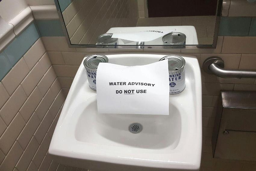 A sign posted at a sink at a Corpus Christi-area health clinic on the morning of Dec. 15, 2016.  City officials announced a …