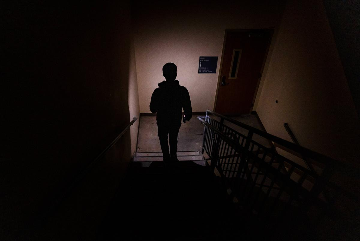 Nicholas Ware, a freshman computer science major at Texas State University, walks down the stairs to his dorm room on campus, which has been without consistent power for days. Feb. 17, 2021.