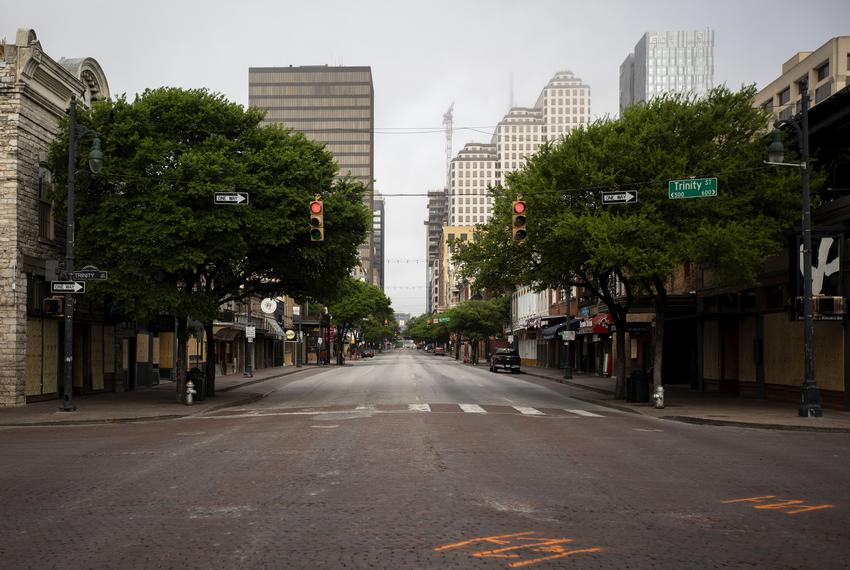 An empty Sixth Street during morning rush hour in Downtown Austin. The city's streets were mostly empty as a result of the...