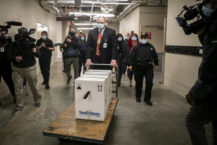 Sidney Phillips, administrative director of Pharmacy at Memorial Hermann Hospital, receives and transports the first Pfizer …