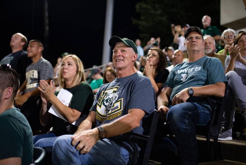 Dr. Chris Mack cheers on the hometeam at the Longview-Lufkin (35-28) season opener football game at Longview High School, ...