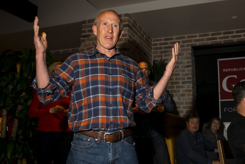 Gary Gates greets the crowd during his election night watch party at Gallery Furniture in Richmond on Tuesday.