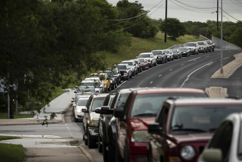 A line of about 100 cars formed at Barbara Jordan Elementary School in Austin while waiting at a COVID-19 testing site. June…