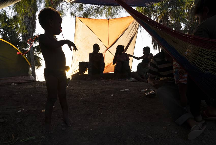 Mexican nationals pass time in an encampment in Matamoros, Tamaulipas,  as they wait their turn to seek asylum in the U.S....