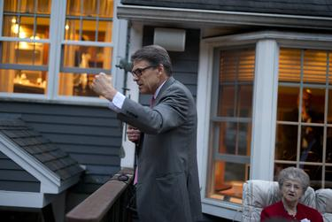 A fired-up Gov. Rick Perry energizes a GOP house party crowd in Nashua, N.H. on Friday.