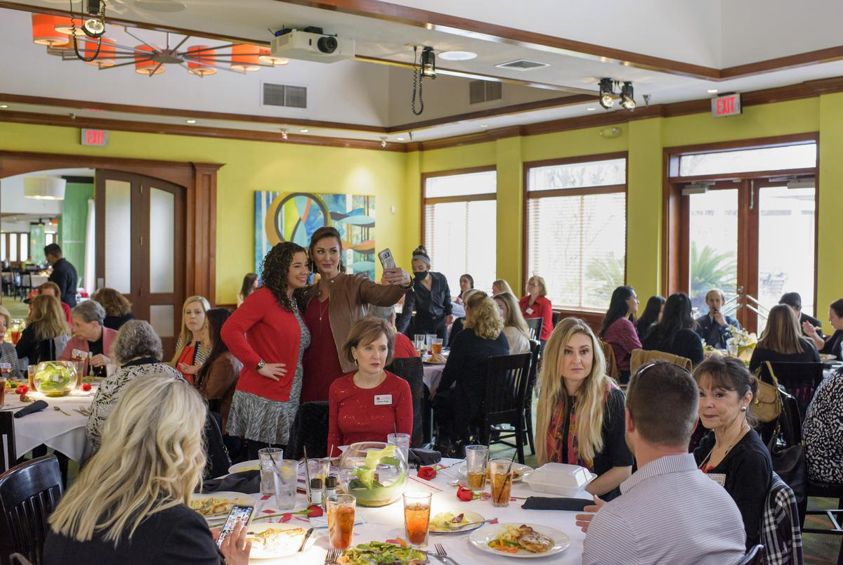 Cat Parks, Republican Party of Texas Vice-Chair, right, eats lunch before speaking to The Woodlands Republican Women's Club at Landry's Seafood in The Woodlands on Feb. 10, 2021.