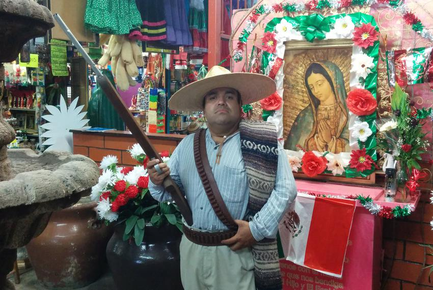 Historian Antonio Ramos poses as a Maderista soldier at a marketplace in Ciudad Juárez, Mexico, on Oct. 8, 2014.