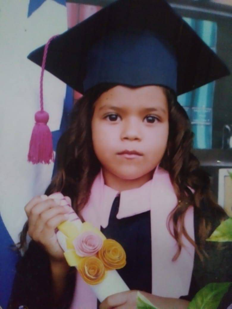 "6-year-old Heyli at her kindergarten graduation. She was sobbing uncontrollably in a recent video call with her mother. ""I never imagined this,"" Heyli can be heard saying."