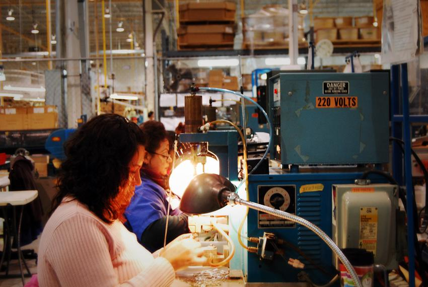 Factory workers in Ciudad Juárez assemble components for hair dryers on a manufacturing line managed by El Paso-based TECMA,…