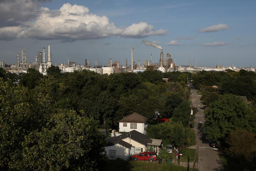 A house stands in the Manchester neighborhood while refineries are visible in the background in Houston on Sept. 8, 2018.