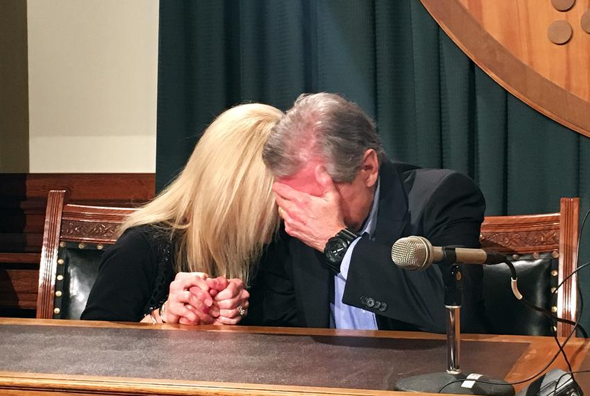 Kent Whitaker and his wife weep upon hearing the news that the parole board recommended to change his son's death sentence...