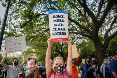 """Hundreds of people joined the """"Texans Rally for Our Voting Rights"""" event to speak out against restrictive voting bills at the Texas Capitol in Austin on May 8, 2021."""