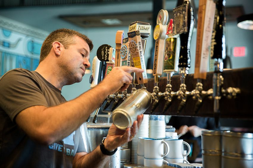 """Mike McKim is on the front lines of state alcohol regulators' attempts to ban """"crowlers,"""" or tap beer sold at bars in cans. After more than a year and a half of legal battles, the TABC returned his crowler machine on Thursday and he resumed crowler sales on Friday."""