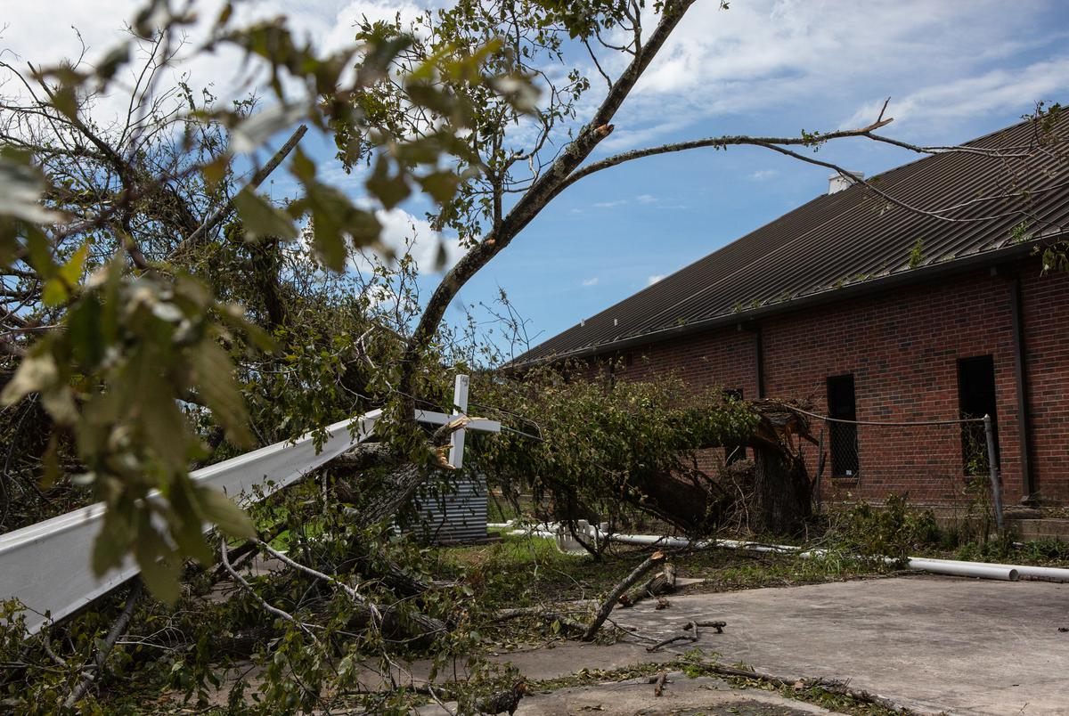 The Mount Calvary Baptist Churchís steeple lays entangled with tree debris on the ground after Hurricane Laura blew through Orange on Aug. 27, 2020.