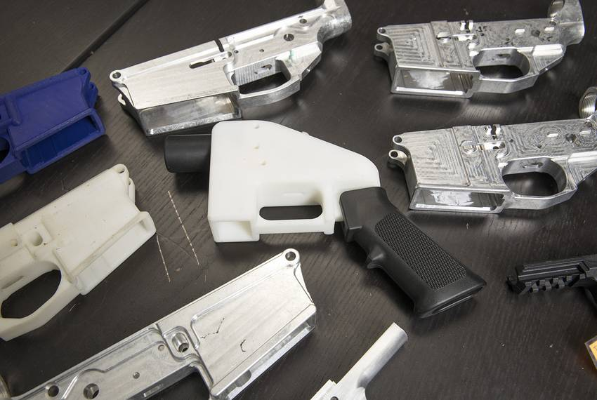 Gun parts at Defense Diistributed, a Texas-based company developing and publishing open source gun designs for 3-D printing and manufacture, surround a copy of The Liberator, a 3D printed plastic gun. The company is being sued to keep its plans for plastic guns off the internet.