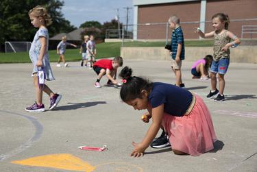Kindergarten students enjoy recess on the first day of in-person classes at Highland Village Elementary on Sept. 8, 2020.