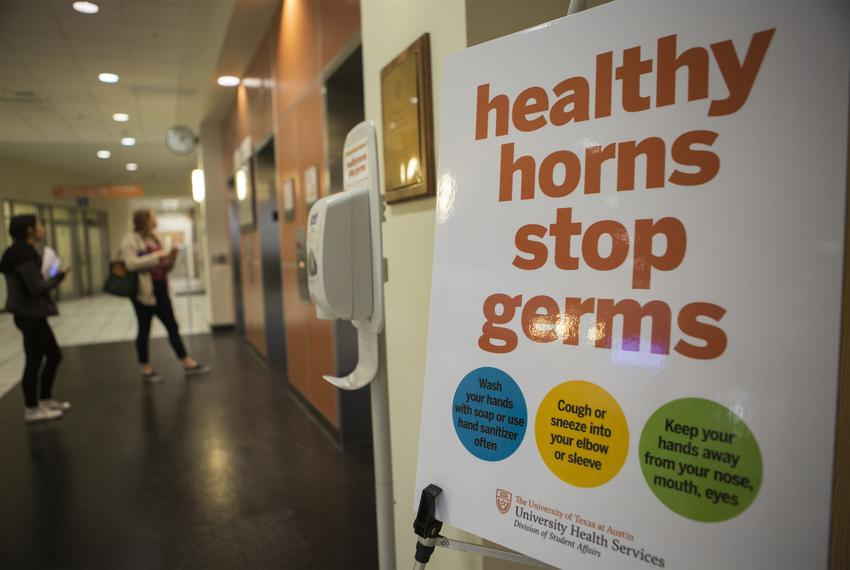 Healthyhorns signage at UT Austin's Student Services Building with information on how to prevent the spread of diseases, o...