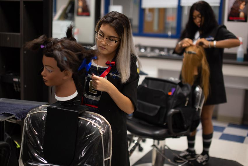 Elizabeth Ruvalcaba and Rahslyn Stallings practice styling techniques in a cosmetology class at Jack C. Hays High School i...