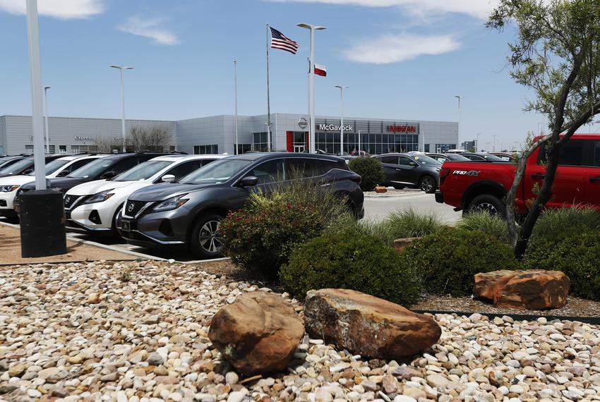 McGavock Nissan cars are lined up their lot at their Lubbock dealership on May 13, 2020. McGavock opened their business duri…