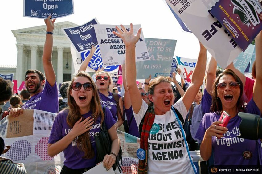 Demonstrators celebrated at the U.S. Supreme Court on June 27, 2016, after the court struck down a Texas law imposing strict abortion regulations.