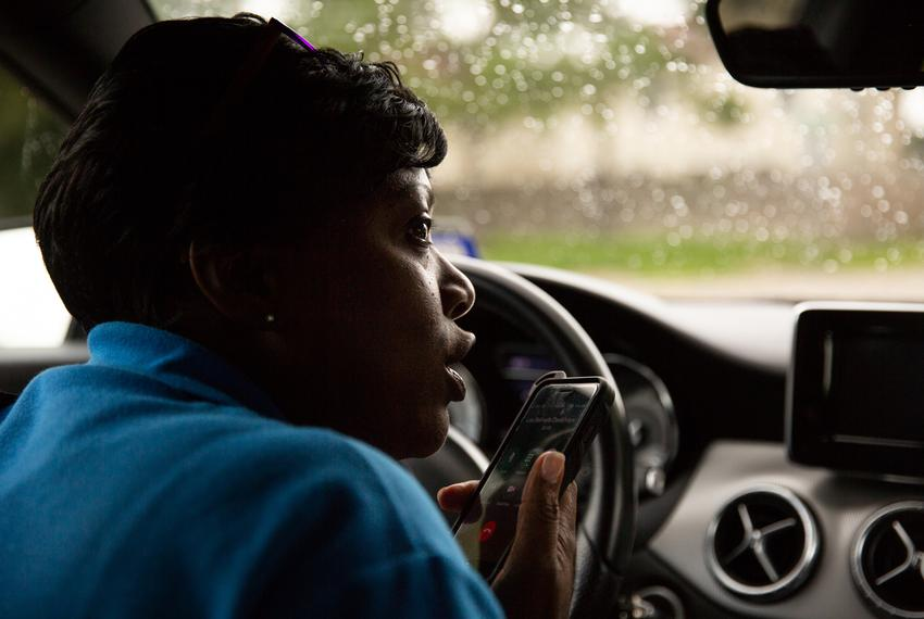 Charla Gilliam, APS In-Home Specialist, calls her client as she's on the way to for an in-home checkup on June 20, 2018.