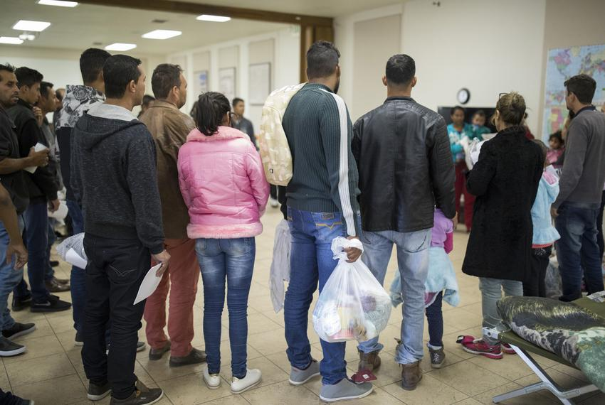 A group of migrants from Brazil arrive at a migrant shelter at the Catholic Diocese of El Paso's main campus, Tuesday, April…