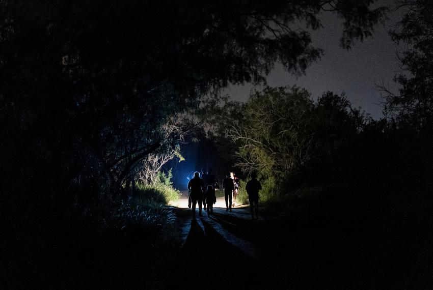 Asylum-seeking migrant families walked to turn themselves into the U.S. Border Patrol after crossing the Rio Grande river in…