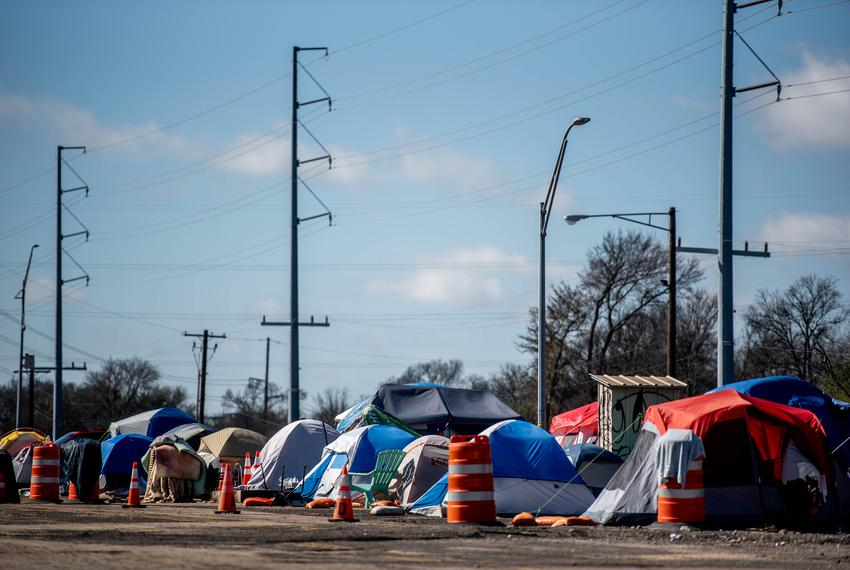 Tents line up in parking spaces at the former TxDOT facility, now 5 acres of state-sanctioned homeless campsite on Jan. 23, …