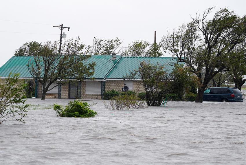A ranch house is surrounded by floodwaters from Hurricane Harvey near Port Lavaca on August 26, 2017.
