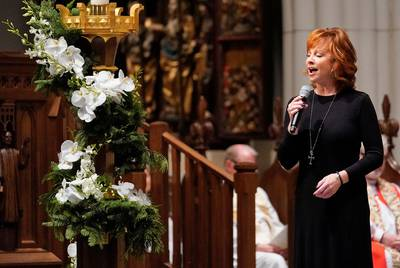 "Reba McEntire sings ""The Lord's Prayer"" during a funeral service for former President George H.W. Bush on Thursday at St. Martin's Episcopal Church in Houston."