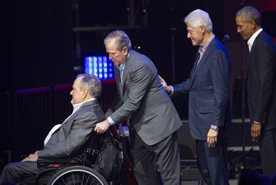 Former presidents George H.W. Bush, George W. Bush, Bill Clinton and Barack Obama in 2017 at a hurricane relief event in College Station. |