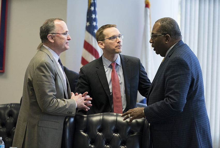 Texas Commission on Public School Finance member Todd Williams of Dallas, left, speaks with Texas Education Agency Commissioner Mike Morath and state Sen. Royce West, D-Dallas, on Jan. 23, 2018.  | by Bob Daemmrich for the Texas Tribune