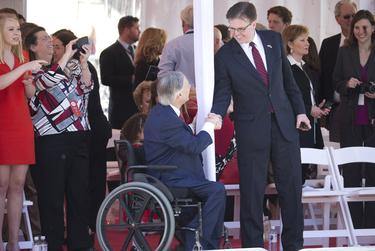Abbott and Lt. Gov. Dan Patrick shake hands at the end of the inaugural parade.