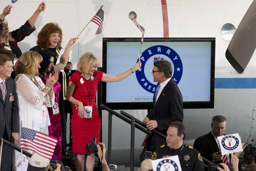 Rick Perry is greeted by supporters as he reaches the stage.