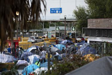 Vehicles pass by tents situated at the entrance of the Gateway International Bridge in Matamoros, Tamaulipas on Oct. 16, 2019.