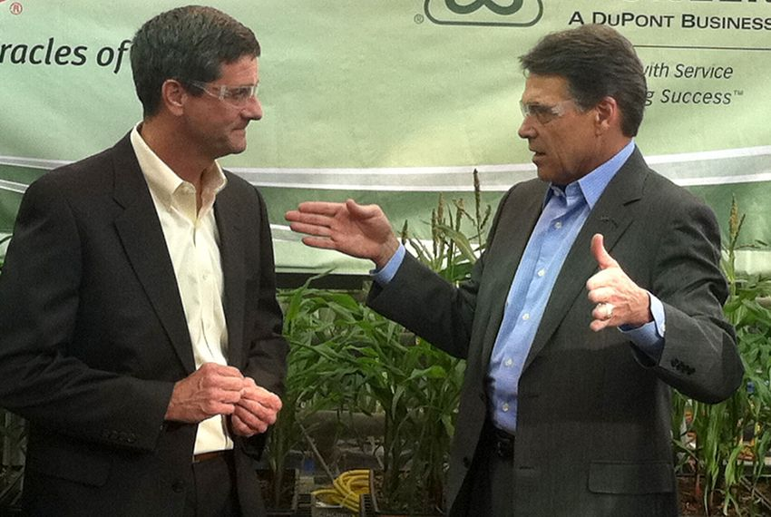 Rick Perry at greenhouse at Pioneer, an agricultural company in Johnston, Iowa. At his left is Lane Arthur, VP for information management. Thursday, Nov. 3.