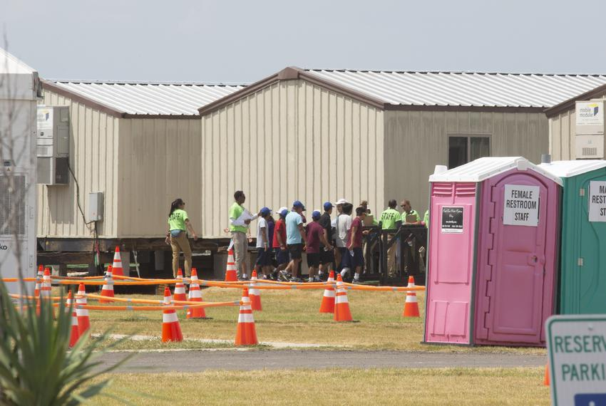 A group of mostly teenage migrants on the grounds of The Studios, a converted temporary shelter for migrant kids in Carriz...