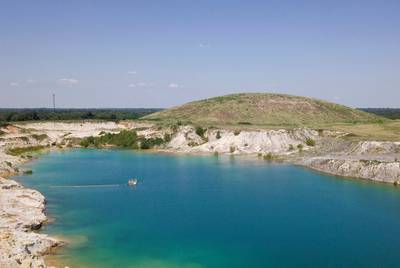 As the mine's owner and former operator, Luminant, continues its restoration of the site, it is gifting the land to the city of Sulphur Springs, which envisions turning the mound into an amphitheater and the pit into a fishing lake. The alluring color of the water in the pit is due to its high acidity.