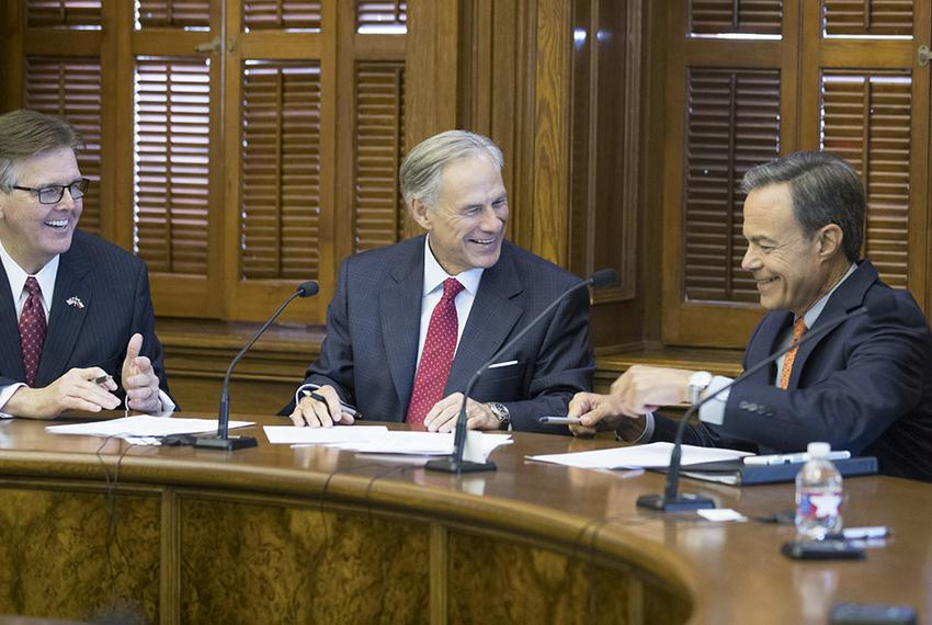 The three leaders of Texas appear jovial at a short meeting of the Cash Management Committee on July 18, 2017, as they face …